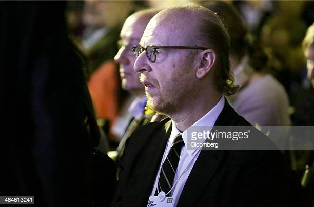 Avram Glazer, co-chairman of Manchester United Plc, watches as David Cameron, U.K. Prime minister, speaks during a session on day three of the World...