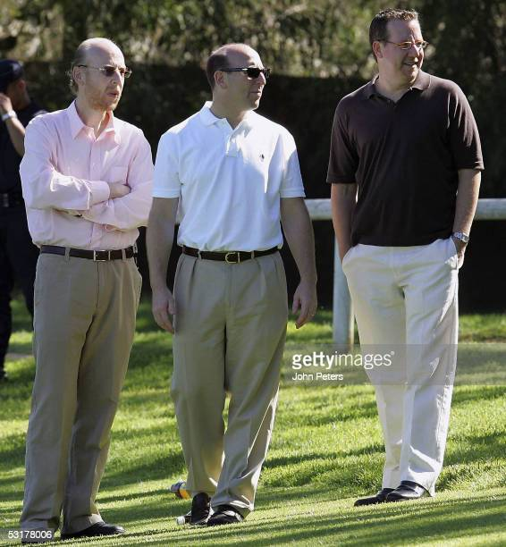 Avram Glazer , Joel Glazer and Bryan Glazer , sons of new owner Malcolm Glazer and new members of the board of directors, watch from the sidelines...
