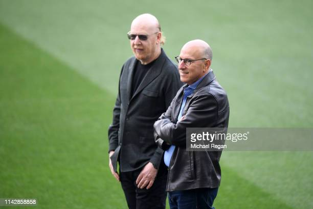 Avram Glazer, Owner of Manchester United looks on as they attend a training session ahead of their second leg in the UEFA Champions League Quarter...