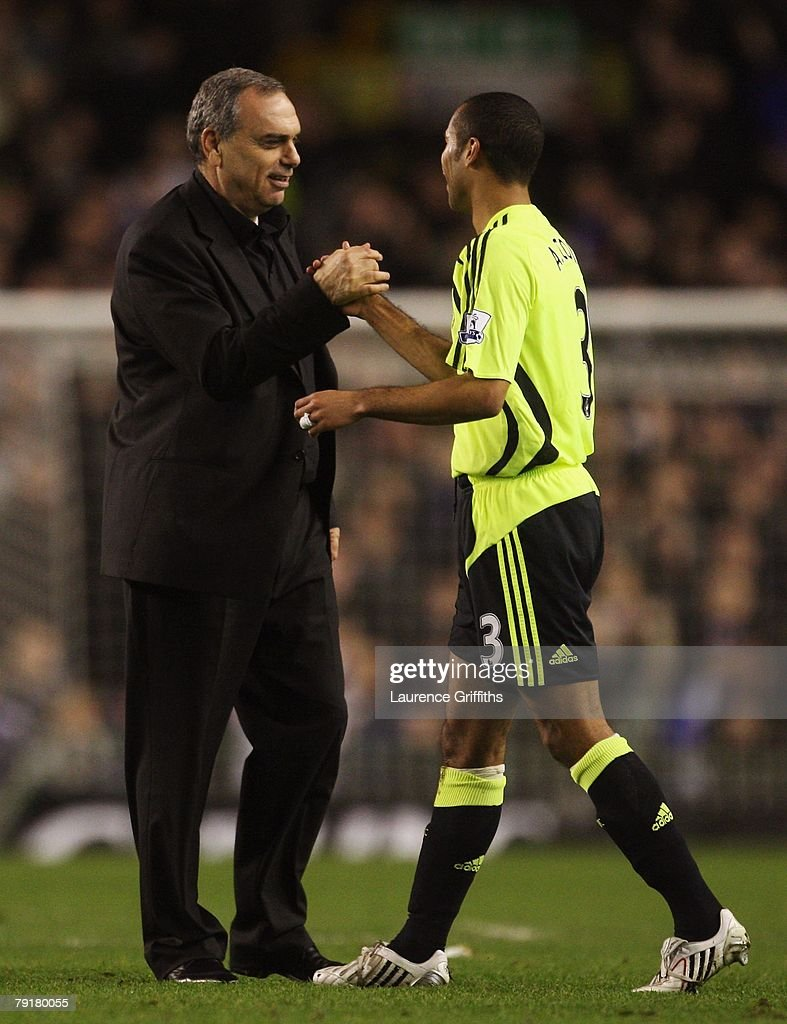 Avram Grant of Chelsea congratulates Ashley Cole after victory in the Carling Cup Semi Final Second Leg match between Everton and Chelsea at Goodison Park on January 23, 2008 in Liverpool, England.