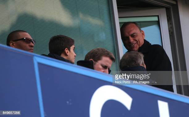 Avram Grant smiles whilst talking with Chelsea owner Roman Abramovich and technical director Michael Emenalo in the stands
