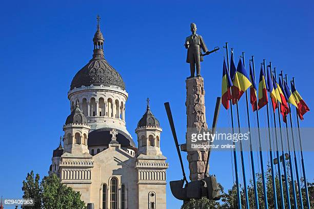 Avram Iancu statue and Orthodox cathedral at Piata Avram Iancu in Cluj Transylvania Romania