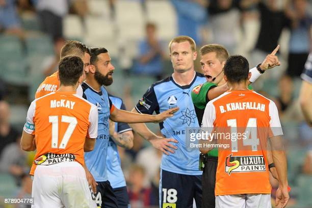 Avram Papadopoulos of Brisbane receives a red card during the round eight ALeague match between Sydney FC and the Brisbane Roar at Allianz Stadium on...