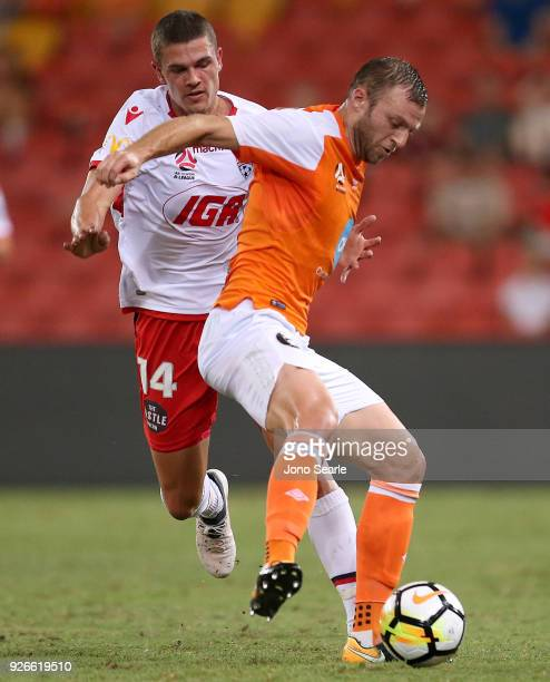 Avram Papadopoulos of the Brisbane Roar and George Blackwood of Adelaide United contest the ball during the round 22 ALeague match between the...