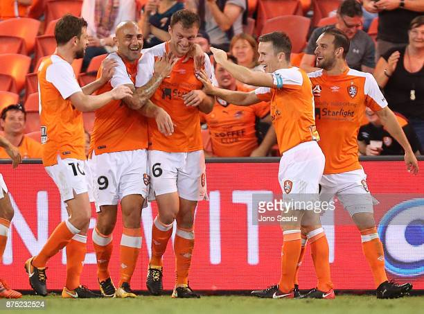 Avram Papadopoulos of the Brisbane Roar celebrates his goal with team mates during the round seven ALeague match between Brisbane Roar and Melbourne...