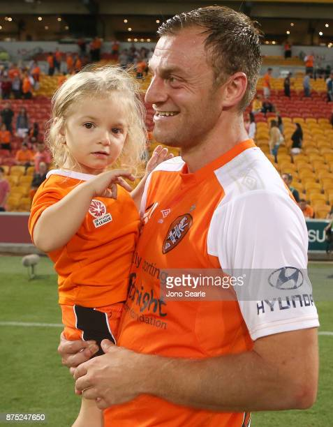 Avram Papadopoulos of the Brisbane Roar celebrates the win with his daughter during the round seven ALeague match between Brisbane Roar and Melbourne...