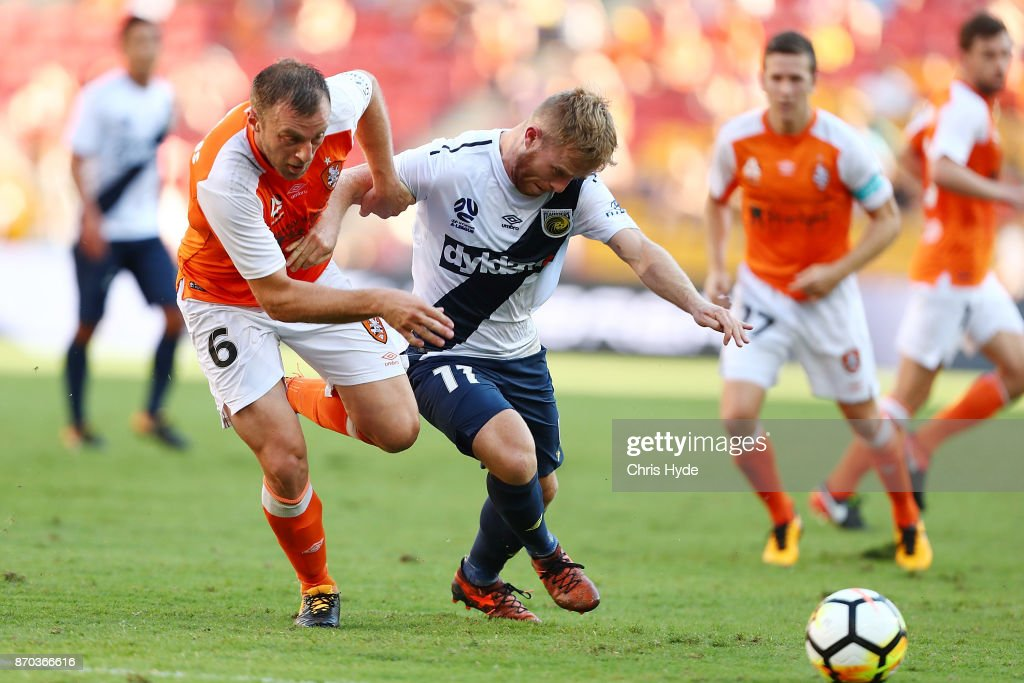 Avram Papadopoulos of the Roar and Connor Pain of the Glory compete for the ball during the round five A-League match between the Brisbane Roar and the Central Coast Mariners at Suncorp Stadium on November 5, 2017 in Brisbane, Australia.