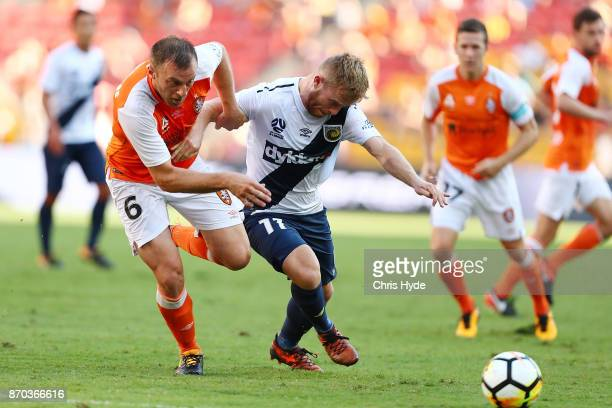 Avram Papadopoulos of the Roar and Connor Pain of the Glory compete for the ball during the round five ALeague match between the Brisbane Roar and...