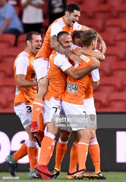 Avram Papadopoulos of the Roar is congratulated by team mates after scoring a goal during the round 17 ALeague match between the Brisbane Roar and...