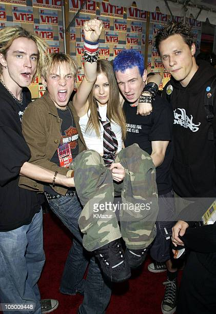 Avril Lavigne and band during 2002 MTV Video Music Awards Arrivals at Radio City Music Hall in New York City New York United States