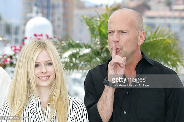 Avril Lavigne and Bruce Willis during 2006 Cannes Film Festival 'Over The Hedge' Photocall at Palais des Festival in Cannes France