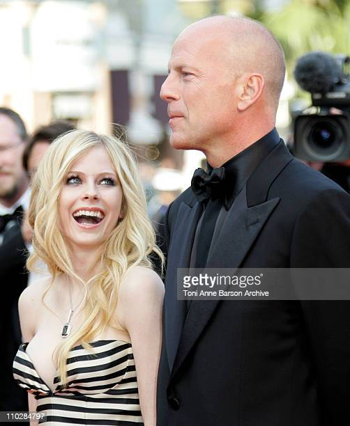 Avril Lavigne and Bruce Willis during 2006 Cannes Film Festival Over The Hedge Premiere at Palais des Festival in Cannes France