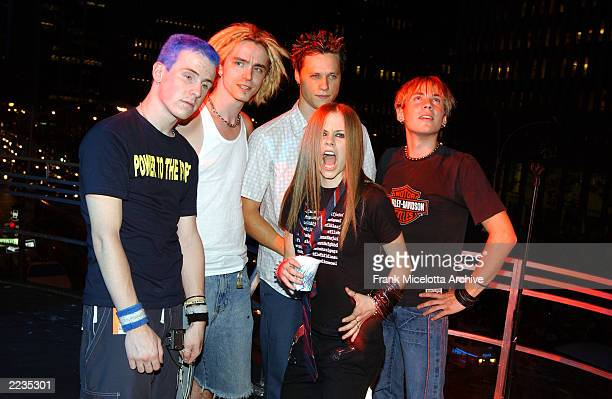 Avril Lavigne and her band after rehearsing for the 2002 MTV Video Music Awards on the marquee overlooking Avenue of the Americas at Radio City Music...