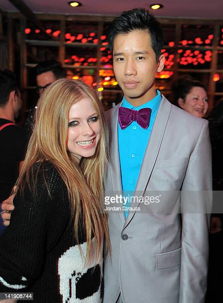 Avril Lavigne and Jared Eng attend Just Jared's 30th at Pink Taco on March 23 2012 in Los Angeles California