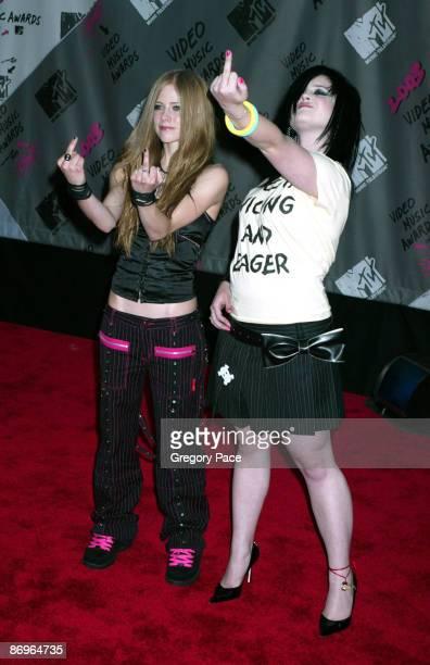Avril Lavigne and Kelly Osbourne, wearing a Karen Walker outfit