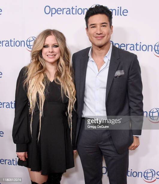 Avril Lavigne and Mario Lopez arrive at Operation Smile's Hollywood Fight Night at The Beverly Hilton Hotel on November 6, 2019 in Beverly Hills,...