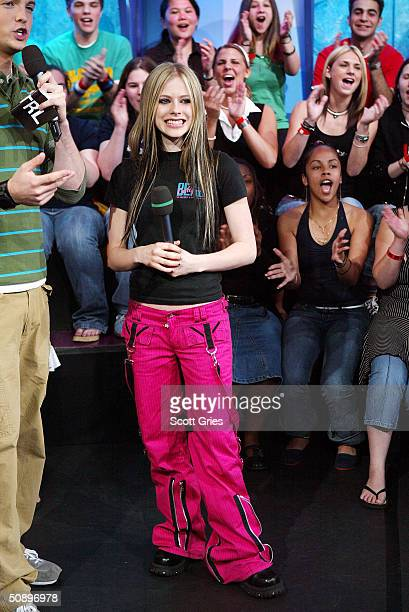 Avril Lavigne appears on stage during MTV's Total Request Live at the MTV Times Square Studios May 25, 2004 in New York City.