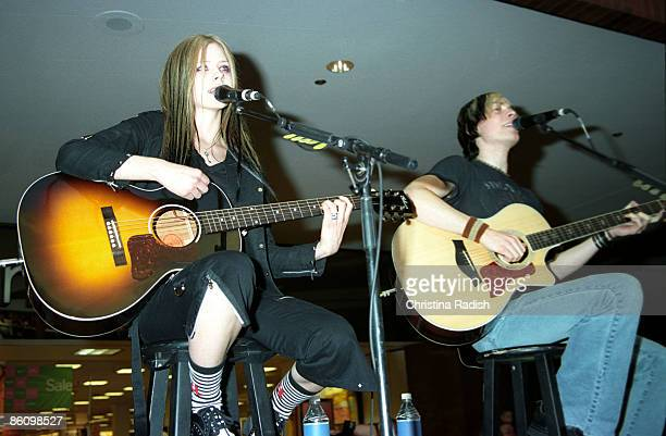 Avril Lavigne Evan Taubenfeld performing during her mall tour to promote her upcoming album 'Under My Skin' at a stop at the Glendale Galleria in...