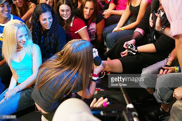 Avril Lavigne licks a fans foot for $100 during TRL at the MTV Studios in New York City 8/22/02 Photo by Scott Gries/Getty Images
