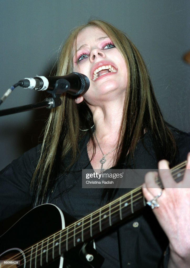 Avril Lavigne performing during her mall tour to promote her upcoming album 'Under My Skin' at a stop at the Glendale Galleria in Glendale, Calif. on April 12, 2004., : News Photo