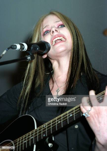 Avril Lavigne performing during her mall tour to promote her upcoming album 'Under My Skin' at a stop at the Glendale Galleria in Glendale Calif on...