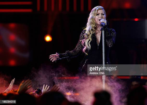 Avril Lavigne performing on We Day at Rogers Arena on October 18 2013 in Vancouver Canada