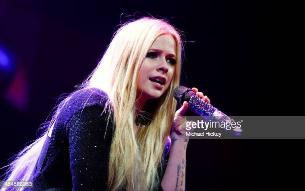 Avril Lavigne performs at the 103.5 KISS FM's Jingle Ball 2013 at United Center on December 9, 2013 in Chicago, Illinois.