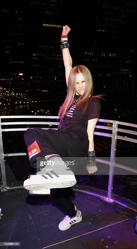Avril Lavigne performs on the roof of Radio City Music Hall during rehearsals for the 2002 MTV Video Music Awards.
