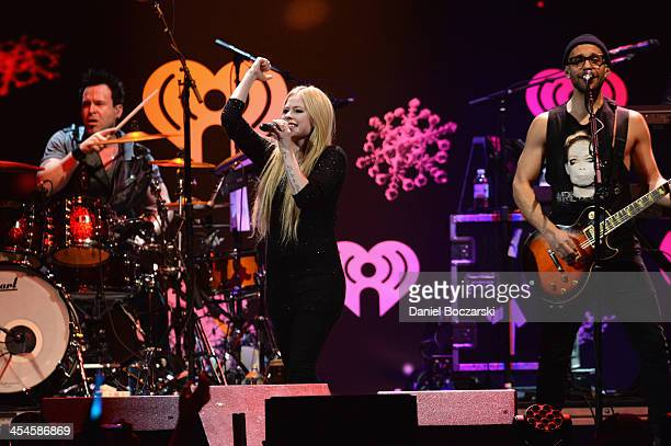 Avril Lavigne performs onstage during 1035 KISS FM's Jingle Ball 2013 presented by Jam Audio Collection at United Center on December 9 2013 in...