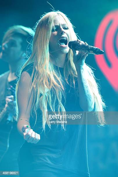 Avril Lavigne performs onstage during Y100's Jingle Ball 2013 Presented by Jam Audio Collection at BBT Center on December 20 2013 in Miami Florida