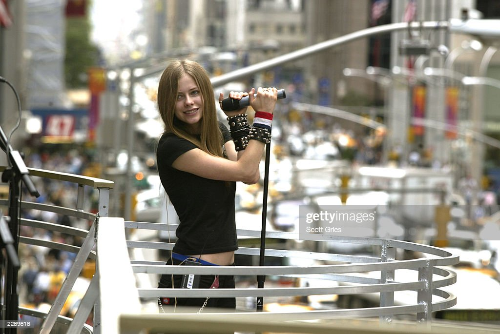 Avril Lavigne rehearsing for the 2002 MTV Video Music Awards on the marquee overlooking Avenue of the Americas at Radio City Music Hall in New York City, August 28, 2002. Photo by Scott Gries/ImageDirect.