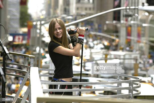 Avril Lavigne rehearsing for the 2002 MTV Video Music Awards on the marquee overlooking Avenue of the Americas at Radio City Music Hall in New York...