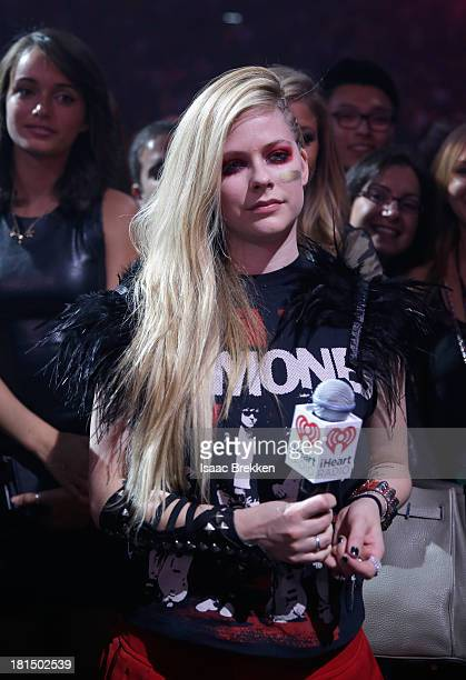 Avril Lavigne speaks during the iHeartRadio Music Festival at the MGM Grand Garden Arena on September 21 2013 in Las Vegas Nevada