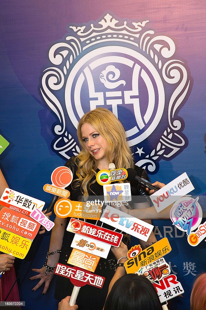 Avril Lavigne speaks to media after winning Best Global Singer at the 2013 Huading Awards ceremony at The Venetian on October 7, 2013 in Macau, Macau.