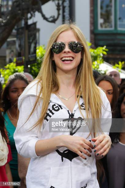 Avril Lavigne visits 'Extra' at The Grove on March 13 2012 in Los Angeles California