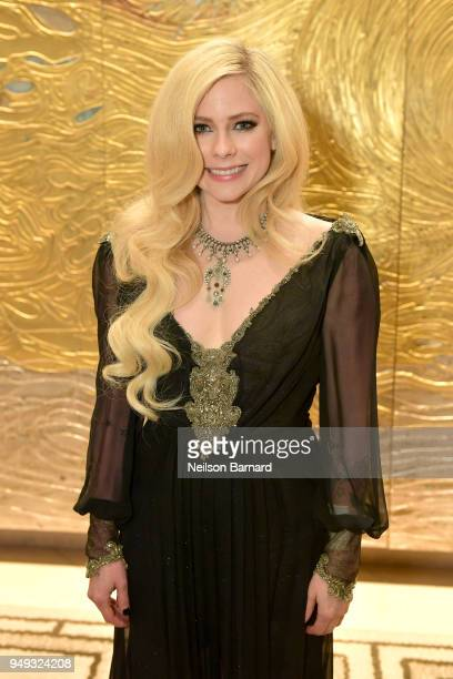 Avril Lavigne wearing peace love jewelry by Nancy Davis attends the 25th Annual Race To Erase MS Gala at The Beverly Hilton Hotel on April 20 2018 in...