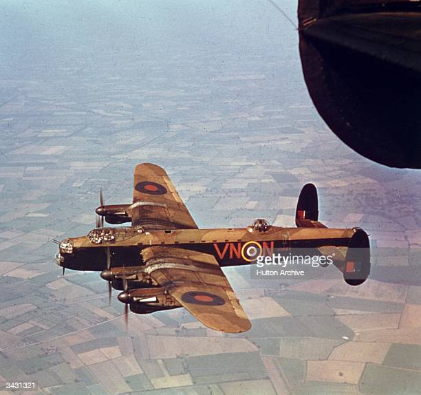 Avro Lancaster heavy bomber R5689 of No 50 Squadron RAF in flight during World War II 1942 The aircraft was delivered to 50 Squadron in June 1942 but...