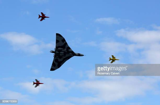 Avro Vulcan XH558 last airworthy Vulcan in the world flies in formation with Gnat display team as part of the 10th Anniversary air show at Wings and...