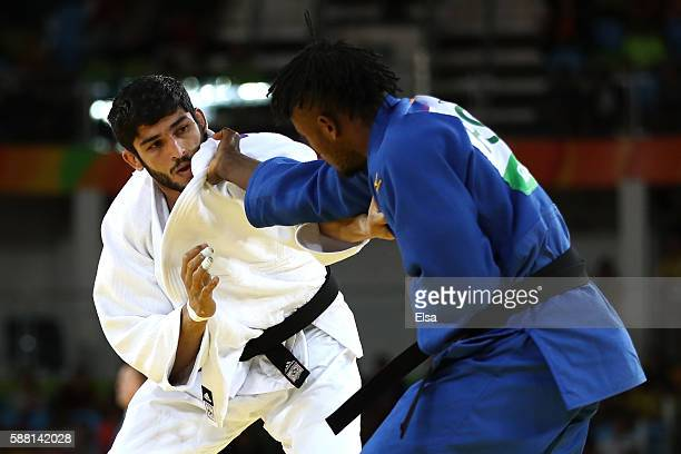 Avtar Singh of India competes against Popole Misenga of the Refugee Olympic Team during a Men's -90kg bout on Day 5 of the Rio 2016 Olympic Games at...