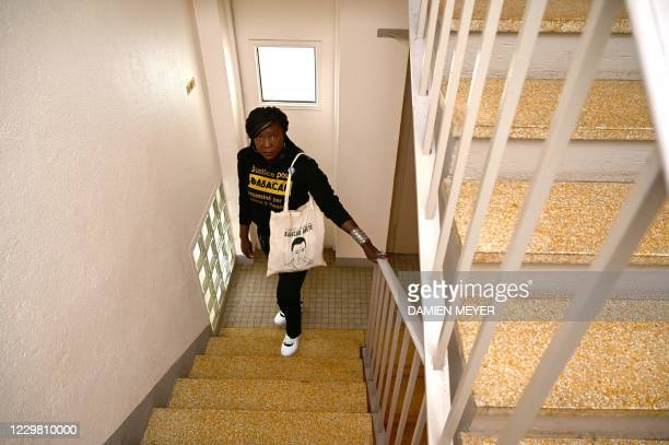 Awa Gueye stands in the spot on the stairwell where her brother Gueye was killed on December 2015, in Rennes, western France on November 25, 2020.