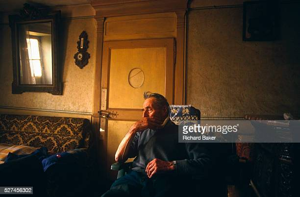 Awaiting the visit from his local country doctor to pay him a visit to his remote French farmhouse an elderly gentleman sits alone in his favourite...
