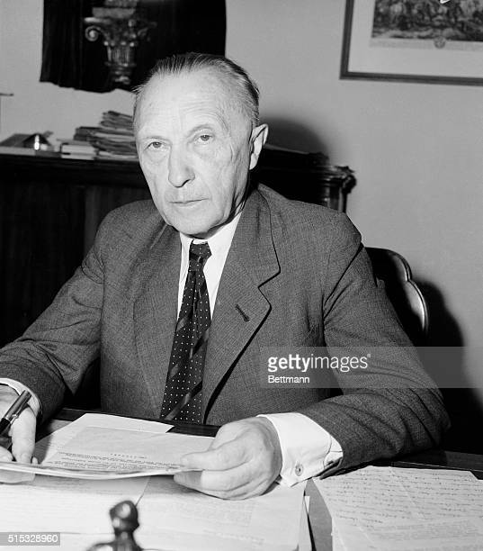Awaits Appointment. Bonn, West Germany: Dr. Konrad Adenauer leader of the Christian Democrats, sits at his desk in his residence near Bonn. He will...