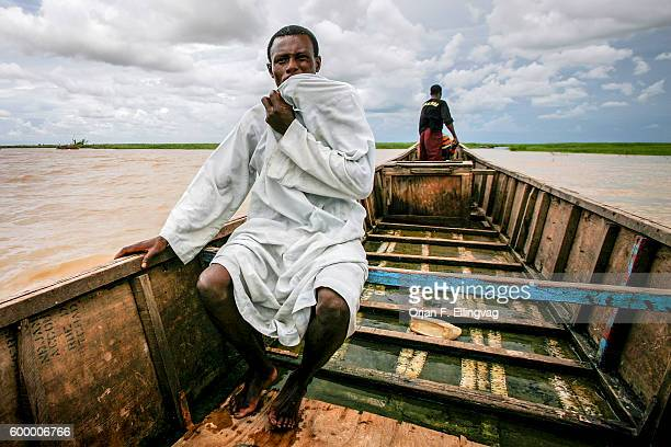 Awalu Garba on a boat trip on Lake Chad A former fisherman he switched to driving passengers on his moped from what used to be a harbor in Guité to...