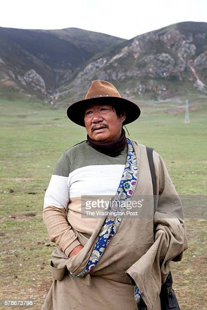 Awang Chunky, around 70, poses for a portrait in the land he owns nearby Yushu, in the southern part of Qinghai province. He is a yak herder.