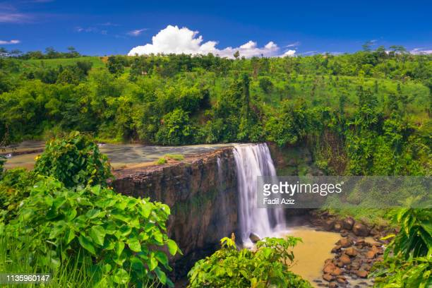 awang waterfall among series of waterfalls in the ciletuh geopark - ジオパーク ストックフォトと画像