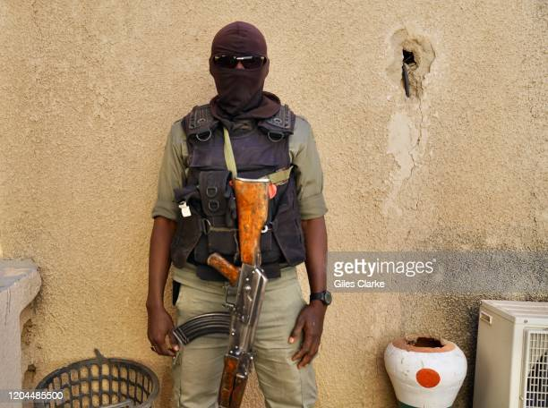 Awaradi Refugee Settlement, Diffa, Niger. December 11 2019. A Niger soldier guarding refugees outside Diffa in the eastern region of Niger.