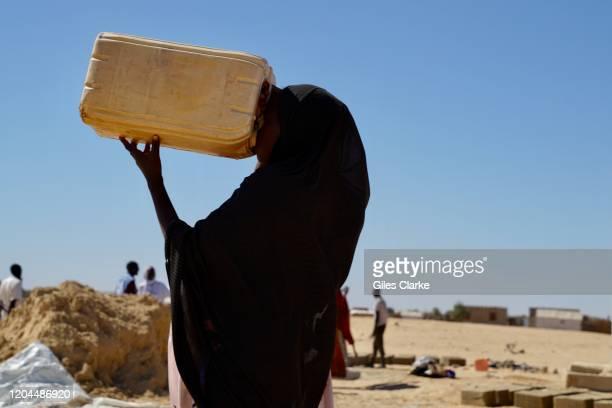 Awaradi Refugee Settlement, Diffa, Niger. December 11 2019. Refugee Girl Drinking Water In Niger