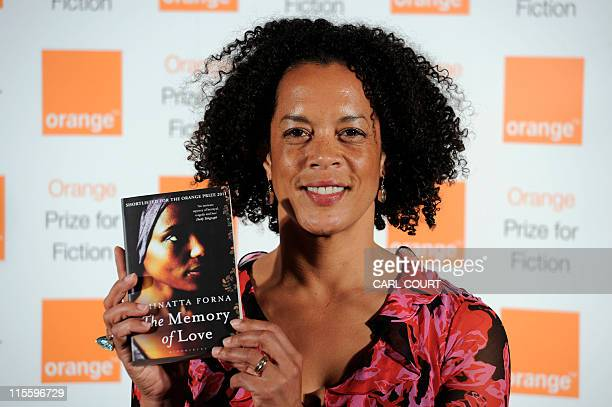 Award nominated British author Aminatta Forna poses with her book The Memory of Love at the Orange Prize for Fiction 2011 in the center of London on...