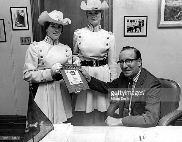 JUN 14 1971 JUN 15 1971 Award Presented to Post's Managing Editor by Casper Troopers Gail Jones left and Erna Lindahl color guard commanders of the...
