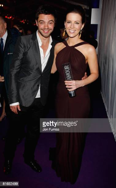 Award presenter Dominic Cooper and actress Kate Beckinsale with her award for Best Film Actress and her mother Judy Loe during the Glamour Women Of...